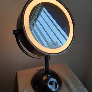 Conair double sided magnifying mirror with light